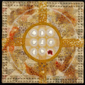 square quilt artwork with a central pattern and surface embellished with stitches and painted imagery