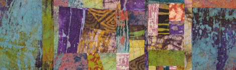 quilted patchwork artwork of hand-decorated fabrics