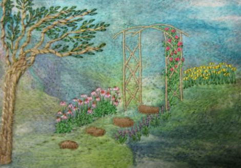 garden scene with embroidered flowers and a trellis with climbing roses