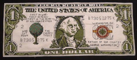 cross-stitched piece of an American dollar bill