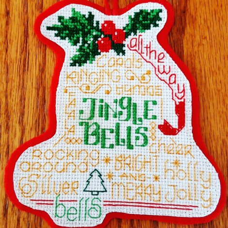 bell shaped ornament with Jingle Bells and other Christmas themed words as decoration