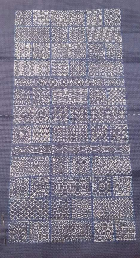 blackwork sampler done with coloured threads