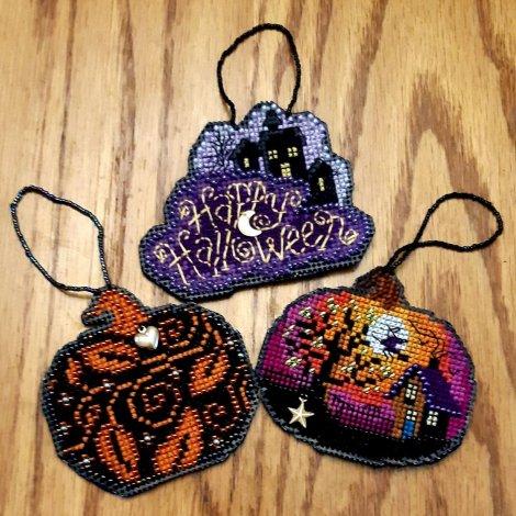 three flat Halloween ornaments