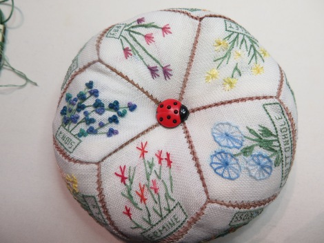 pincushion with flowers