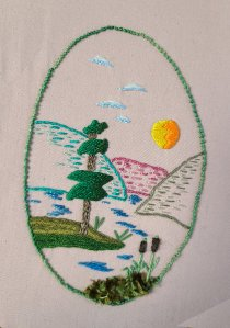 small landscape embroidered in mixed threads