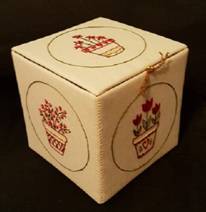 fabric covered box embroidered with flowers in pots