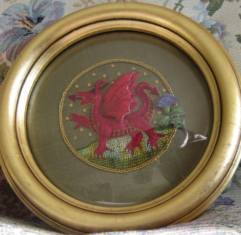 embroidered red dragon in circular frame