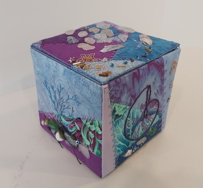 fabric covered box in blues/purples