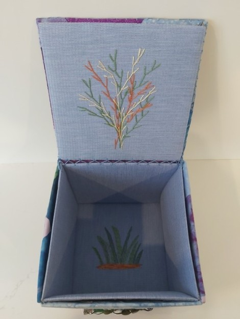 interior of fabric box showing embroidered tree motif