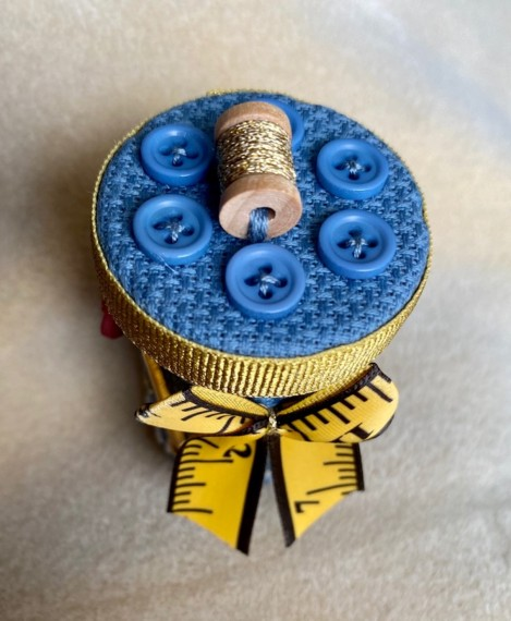 fabric covered pill bottle decorated with charms and buttons