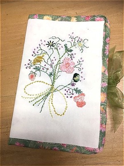 Needlecase with embroidered flowers