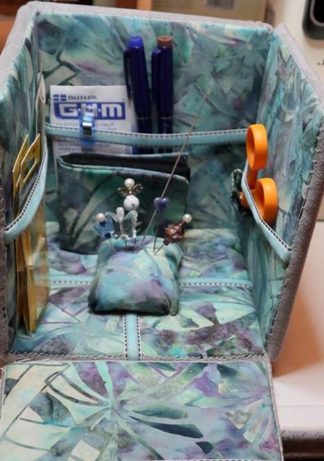 interior of fabric box showing stored needlework items