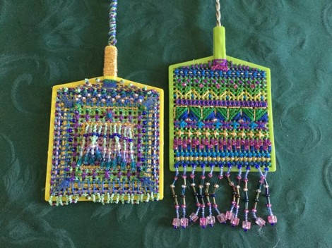 flyswatter encrusted with threads and beads