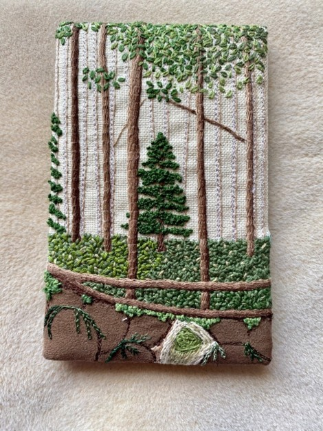 embroidered postcard with woodland scene featuring evergreen tree