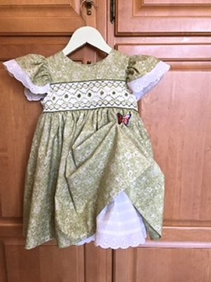 front view of smocked, green dress