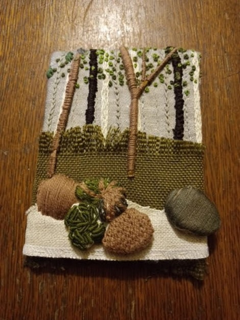 embroidered postcard with woodland scene featuring needlelace