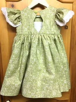 back view of smocked, green dress