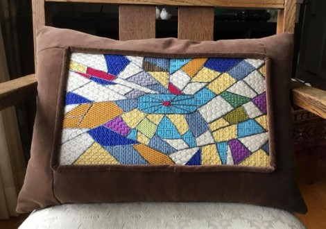 canvas work pillow with crazy quilt theme
