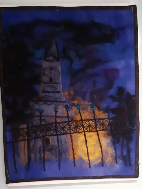 moody embroidery of building at night