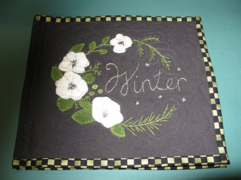 embroidery with flowers and the word Winter