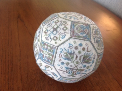 cross-stitched ball with classic designs
