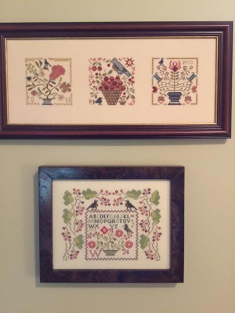 3 sampler-style cross-stitch pieces