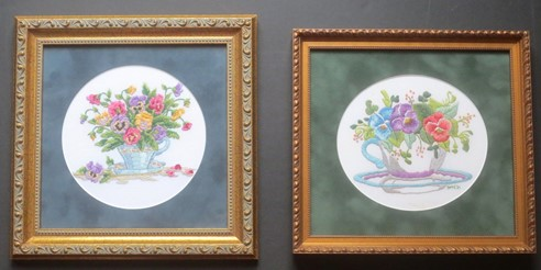 2 framed embroideries of pansies