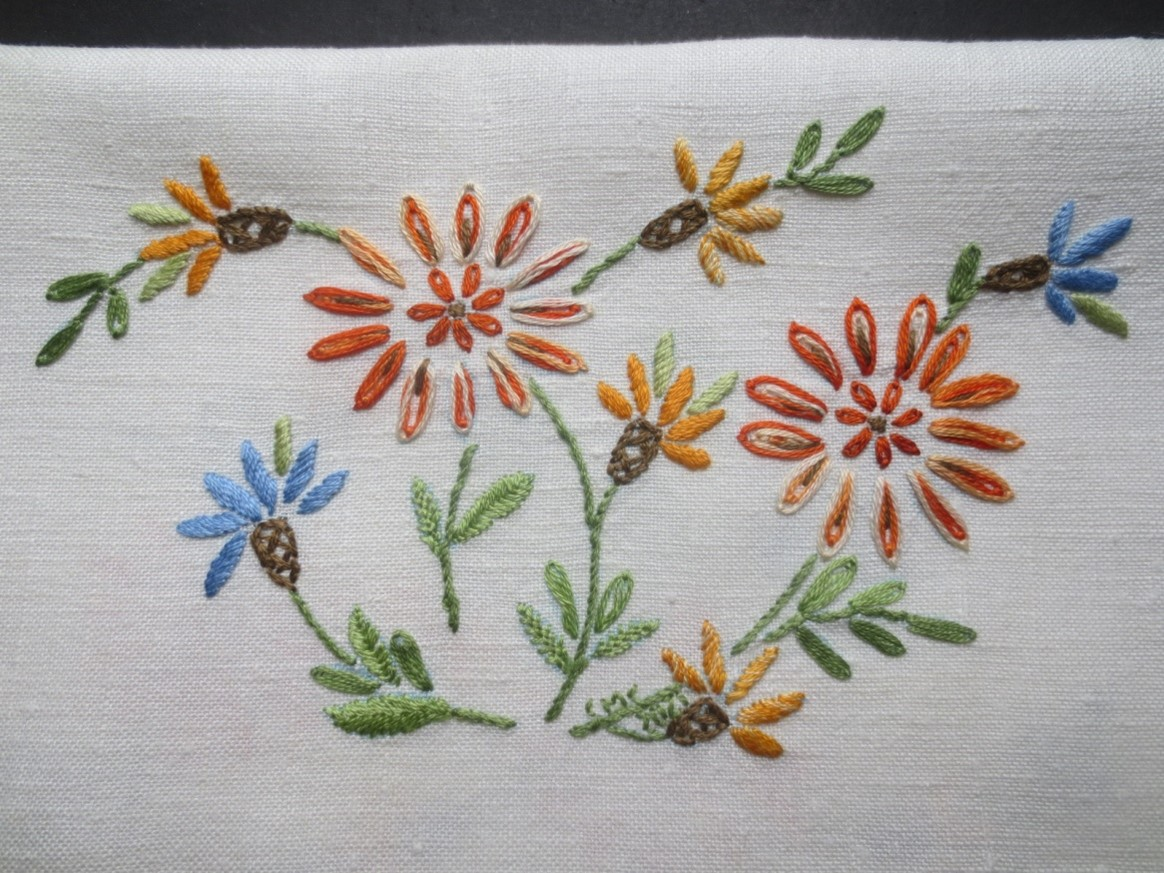 white cloth embroidered with flowers